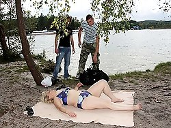 The tender mature babe with the flabby body sucks and fucks the two guys outdoors